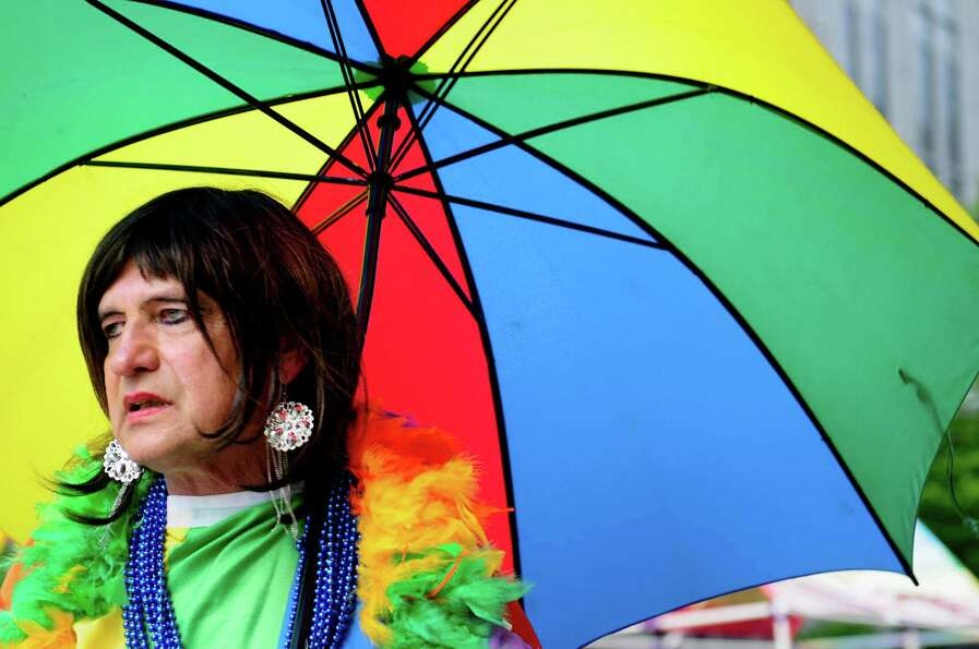 Geegee Tavees, from Kalispell, Mont., carries a colorful umbrella.