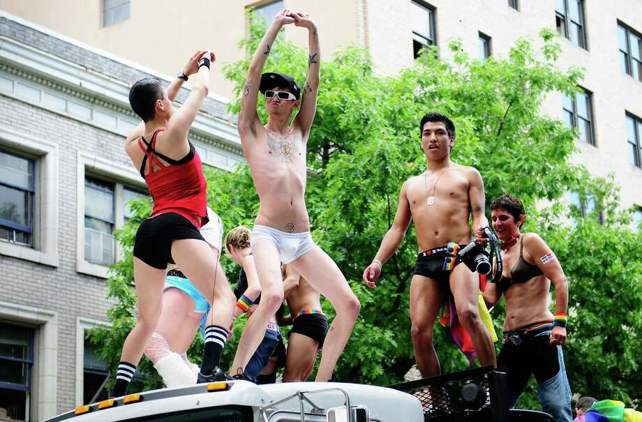 Parade participants dance on the top of a truck. Photo: LINDSEY WASSON / SEATTLEPI.COM