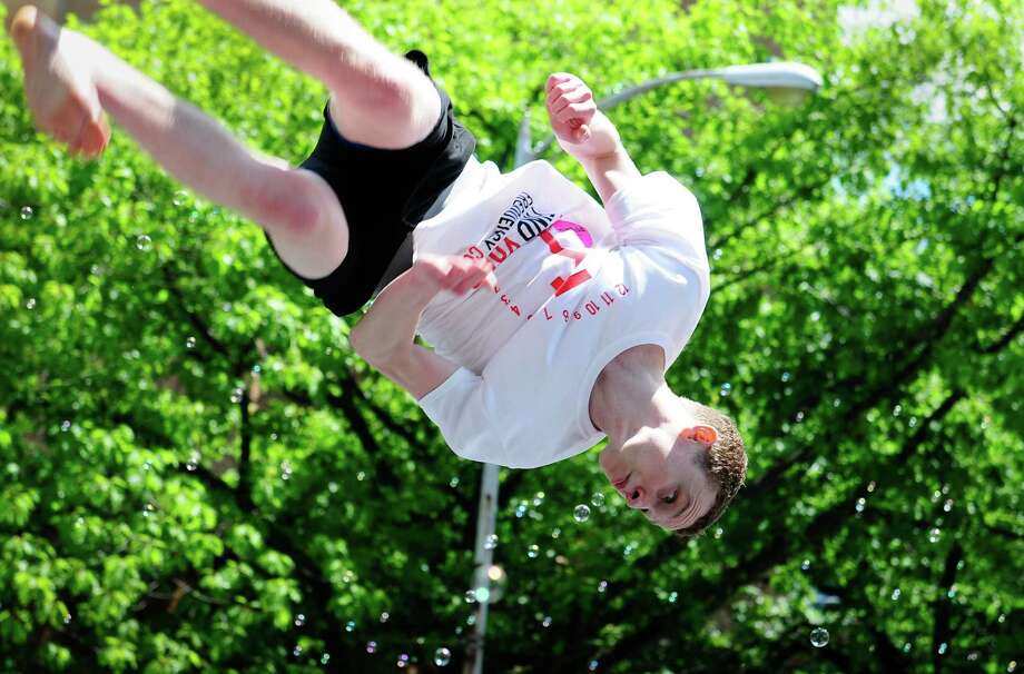 A participant with FindYourFrequency.com jumps on a trampoline. Photo: LINDSEY WASSON / SEATTLEPI.COM