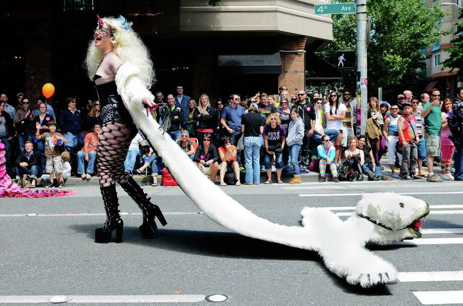 "Kristin kangur with Unicorns from Beyond the Garden of Hedon carries a large polar pear ""pelt"" behind her. Photo: LINDSEY WASSON / SEATTLEPI.COM"