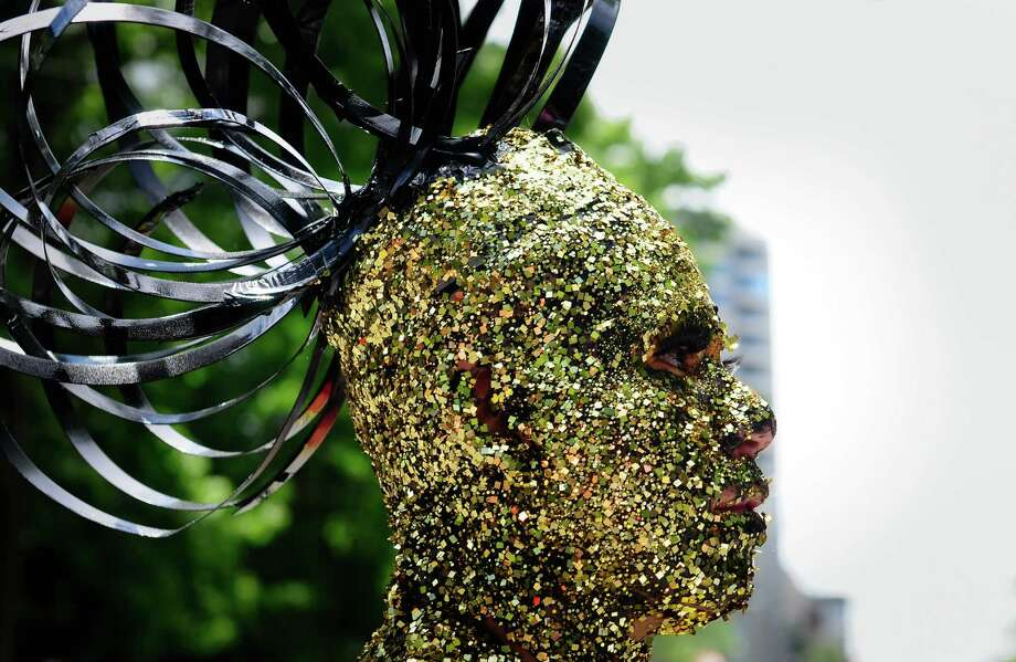 A parade participant is covered in gold glitter. Photo: LINDSEY WASSON / SEATTLEPI.COM