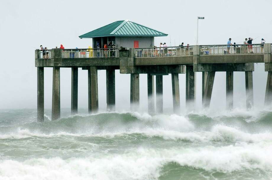 Waves crash against the Okaloosa Island Fishing Pier in Fort Walton Beach, Fla. as wind, waves, and storm from Tropical Storm Debby pound the Florida panhandle Sunday,  June 24, 2012. Louisiana's governor declared a state of emergency as the storm threatens to flood low-lying coastal areas. (AP Photo/Northwest Florida Daily, Devon Ravine) Photo: Devon Ravine