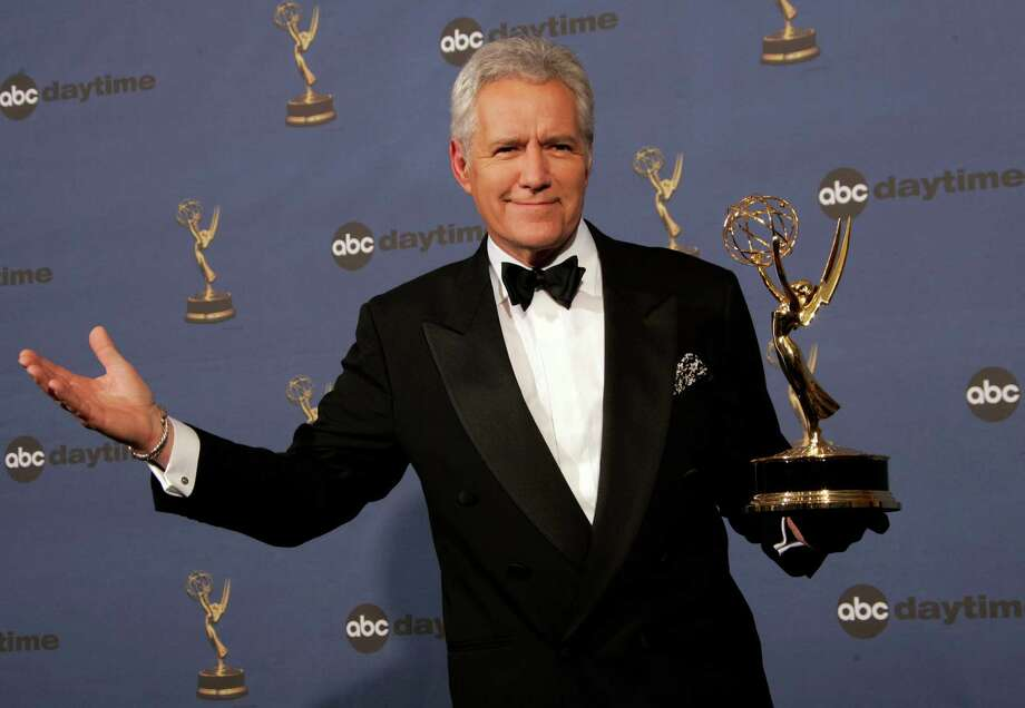 "FILE- In this Friday, April 28, 2006, file photo, Alex Trebek holds the award for outstanding game show host, for his work on ""Jeopardy!"" backstage at the 33rd Annual Daytime Emmy Awards in Los Angeles. Sony Television spokeswoman Paula Askanas said Sunday, June 24, 2012, that Trebek is in a Los Angeles hospital recovering from a mild heart attack. (AP Photo/Reed Saxon, File) Photo: REED SAXON / AP2006"