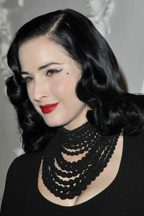 PARIS, FRANCE - JANUARY 25:  Dita von Teese attends the Jean Paul Gaultier Spring/Summer 2012 Haute-Couture Show as part of Paris Fashion Week on January 25, 2012 in Paris, France.  (Photo by Pascal Le Segretain/Getty Images) Photo: Pascal Le Segretain / 2012 Getty Images