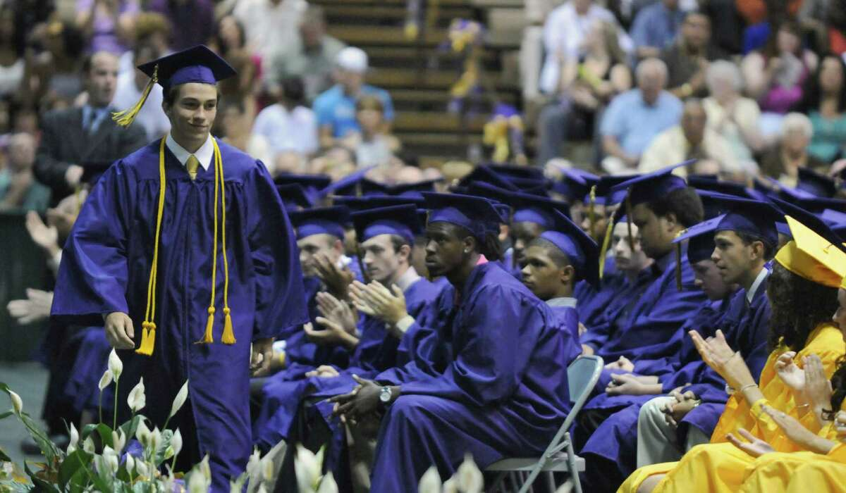 Troy High School salutatorian Jordan Schroeder heads to the stage to give his speech during the school's 153rd Commencement, at Hudson Valley Community College on Sunday June 24, 2012 in Troy, NY. (Philip Kamrass / Times Union)