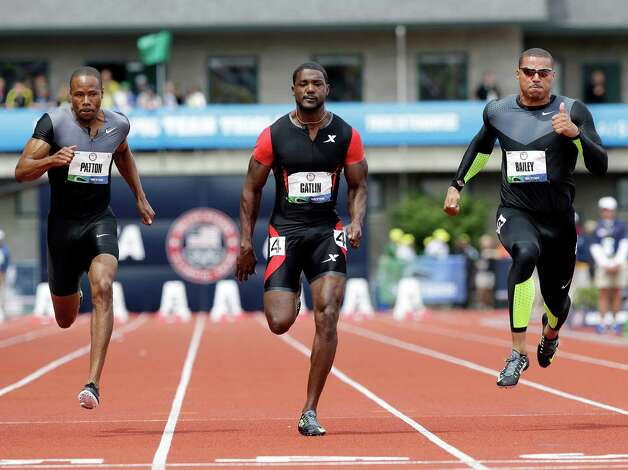 Justin Gatlin leads Darvis Patton and Ryan Bailey during a men's 100m semi final at the U.S. Olympic Track and Field Trials Sunday, June 24, 2012, in Eugene, Ore. (AP Photo/Eric Gay) Photo: Associated Press