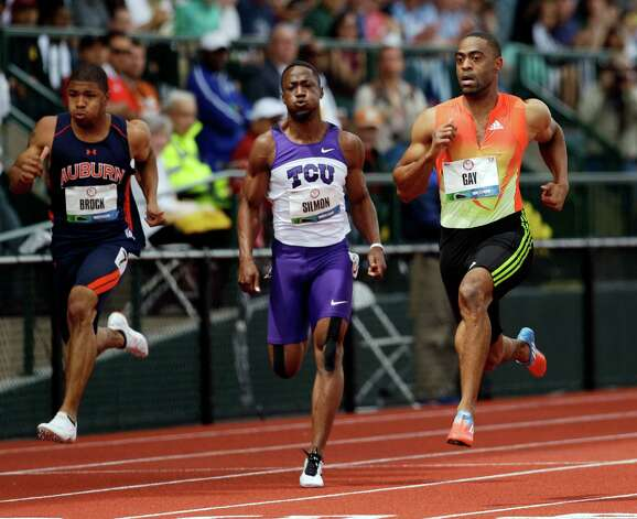 Tyson Gay leads Charles Silmon and Keenan Brock during a men's 100m semi final at the U.S. Olympic Track and Field Trials Sunday, June 24, 2012, in Eugene, Ore. (AP Photo/Marcio Jose Sanchez) Photo: Associated Press