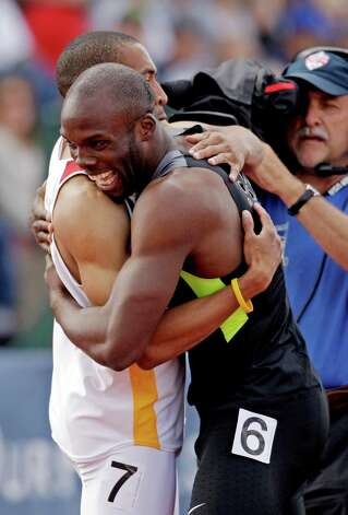 LaShawn Merritt hugs Bryshon Nellum after the men's 400m finals at the U.S. Olympic Track and Field Trials Sunday, June 24, 2012, in Eugene, Ore. (AP Photo/Marcio Jose Sanchez) Photo: Associated Press
