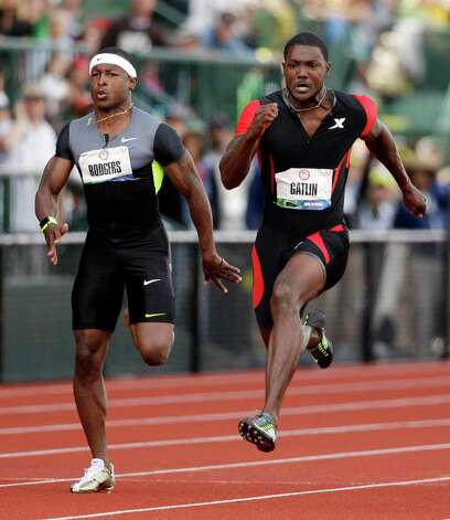Justin Gatlin runs past Michael Rodgers in men's 100m finals at the U.S. Olympic Track and Field Trials Sunday, June 24, 2012, in Eugene, Ore. (AP Photo/Marcio Jose Sanchez) Photo: Associated Press