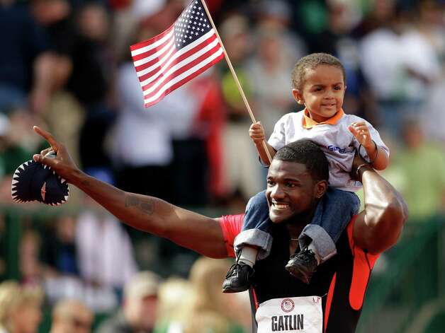Justin Gatlin celebrates with his son Jace after winning the men's 100m finals at the U.S. Olympic Track and Field Trials Sunday, June 24, 2012, in Eugene, Ore.(AP Photo/Marcio Jose Sanchez) Photo: Associated Press