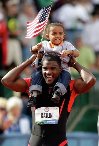 Justin Gatlin celebrates with his son Jace after winning the men's 100m finals at the U.S. Olympic Track and Field Trials Sunday, June 24, 2012, in Eugene, Ore. (AP Photo/Marcio Jose Sanchez) Photo: Associated Press