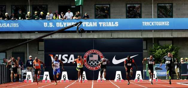 Runners start the men's 100m finals at the U.S. Olympic Track and Field Trials Sunday, June 24, 2012, in Eugene, Ore. (AP Photo/Eric Gay) Photo: Associated Press