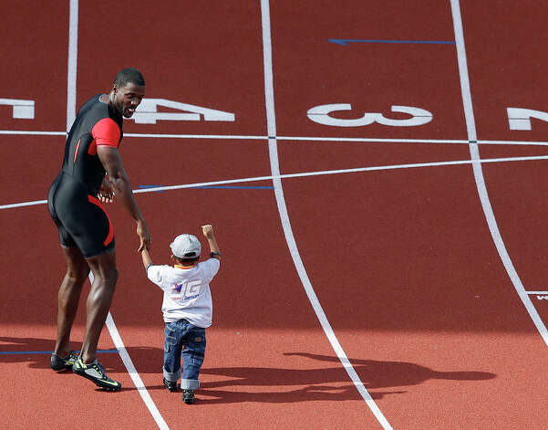 Ryan Bailey celebrates with his son Tyree after the men's 100m finals at the U.S. Olympic Track and Field Trials Sunday, June 24, 2012, in Eugene, Ore. (AP Photo/Charlie Riedel) Photo: Associated Press