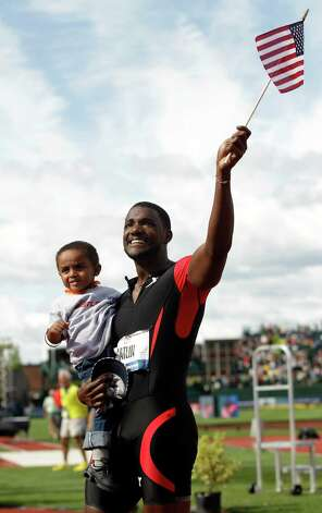 Ryan Bailey celebrates with his son Tyree after the men's 100m finals at the U.S. Olympic Track and Field Trials Sunday, June 24, 2012, in Eugene, Ore. (AP Photo/Marcio Jose Sanchez) Photo: Associated Press