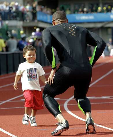 Ryan Bailey celebrates with his son Tyree after the men's 100m finals at the U.S. Olympic Track and Field Trials Sunday, June 24, 2012, in Eugene, Ore. (AP Photo/Eric Gay) Photo: Associated Press