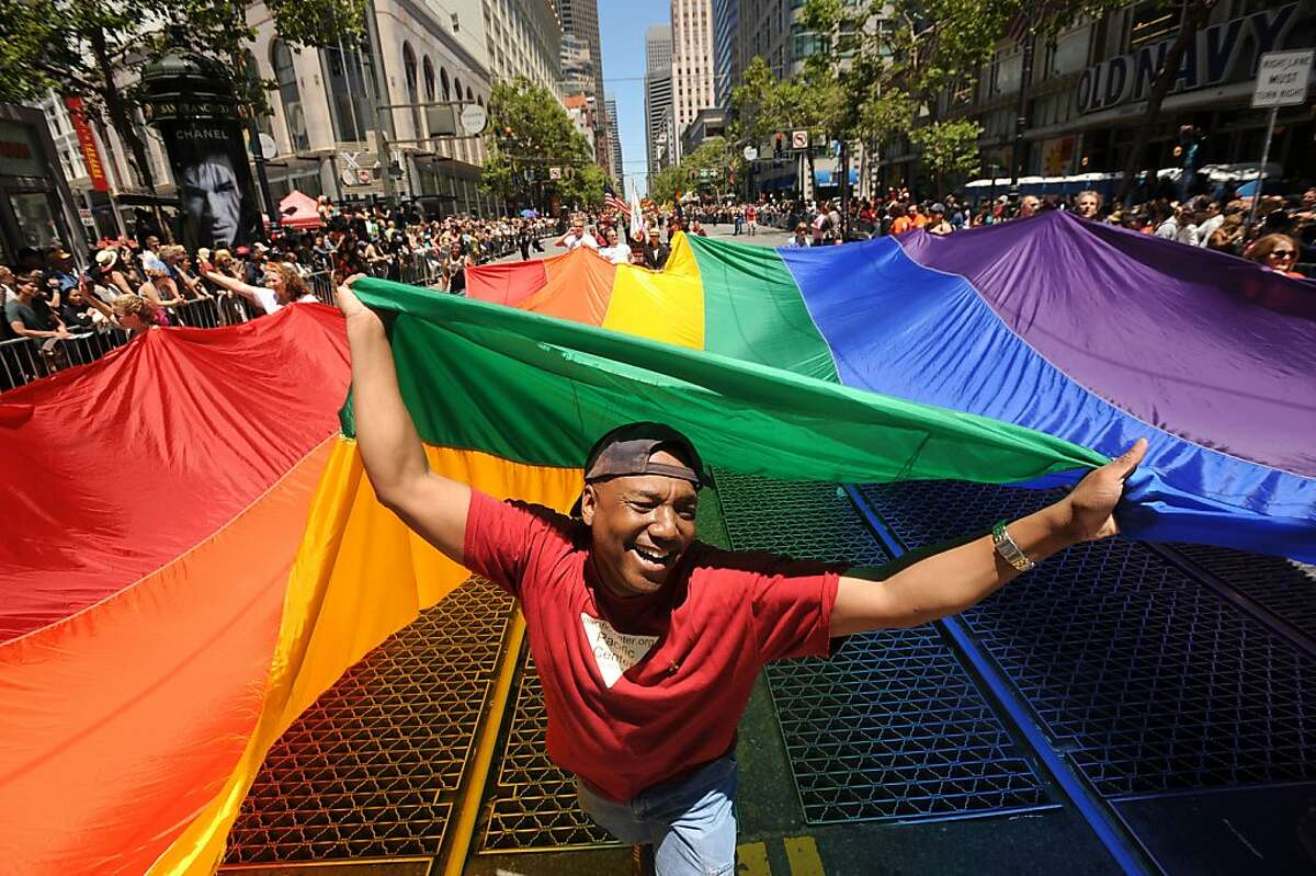 Mark Wilson carries a rainbow flag during San Francisco's 42nd annual gay pride parade on Sunday, June 24, 2012. Organizers say more than 200 floats, vehicles and groups of marchers took part in the parade. (AP Photo/Noah Berger)