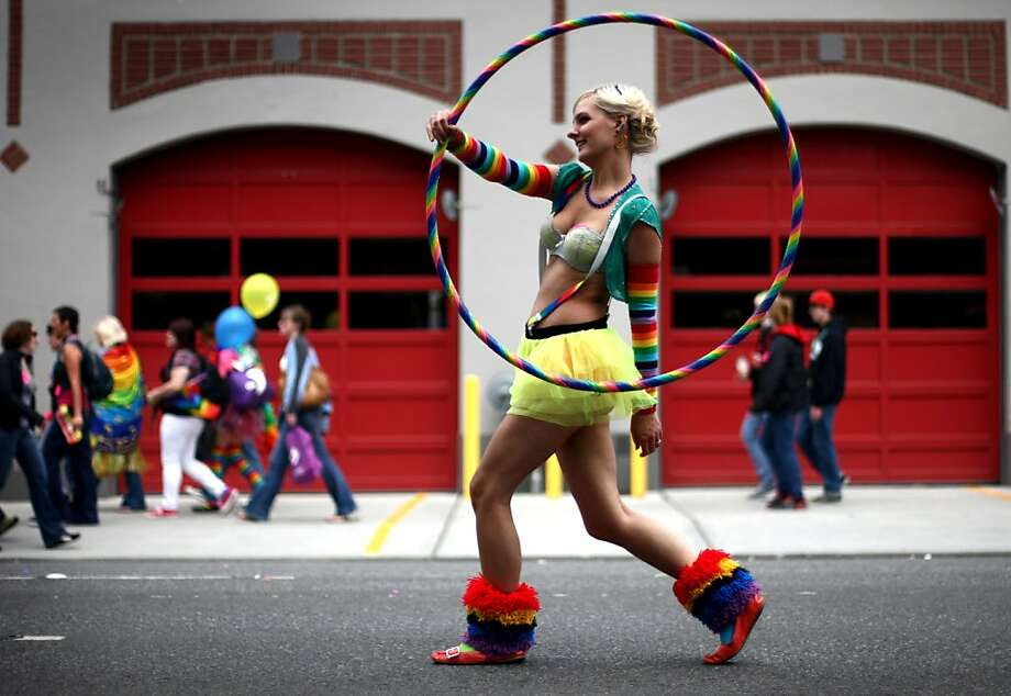 Evelyn Kennedy marches with a hula hoop during Seattle's annual Gay Pride Parade on Sunday, June 24, 2012. (AP Photo/seattlepi.com, Joshua Trujillo) Photo: Joshua Trujillo, Associated Press