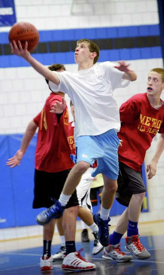 Matt Gurman of the Weston team goes up for a layup during a DeSantis Boys High School Summer basketball league game against the St. Joseph team played at Christian Heritage School, Trumbull, CT on Sunday June 24, 2012 Photo: Mark Conrad / Connecticut Post Freelance