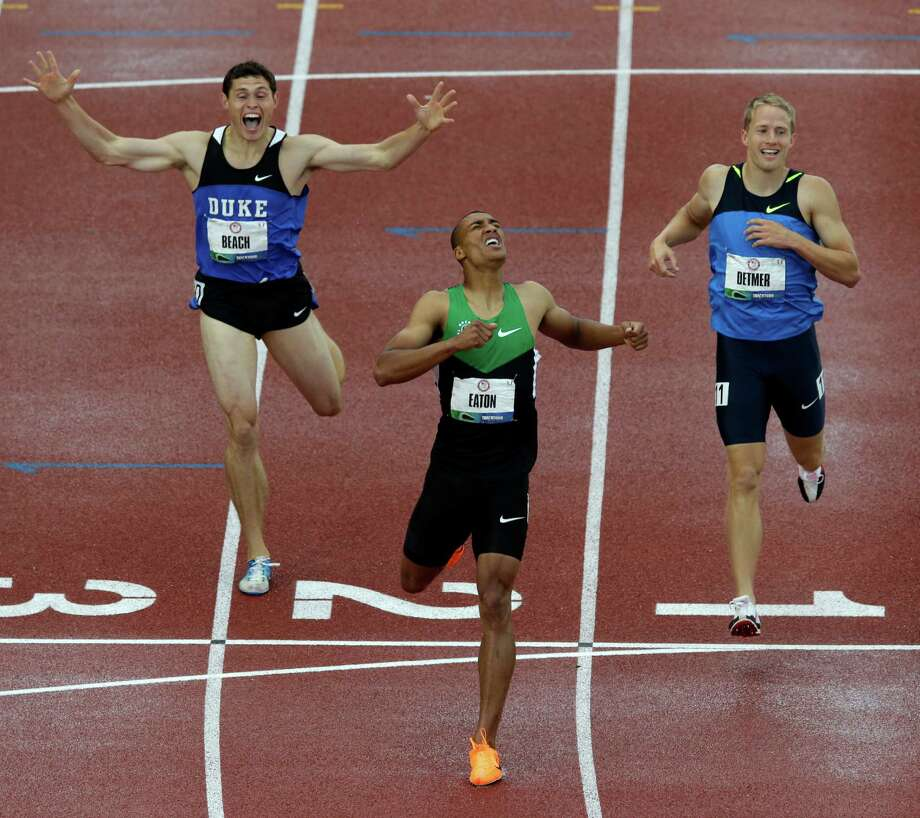 Ashton Eaton reacts with Curtis Beach and Joe Detmer after the 1500m during the decathlon competition at the U.S. Olympic Track and Field Trials Saturday, June 23, 2012, in Eugene, Ore. Eaton finished the decathlon with a new world record. Photo: Charlie Riedel, Associated Press / AP