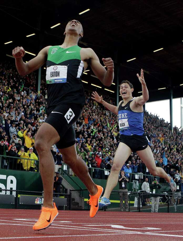 Ashton Eaton and Curtis Beach react after the 1500m during the decathlon competition at the U.S. Olympic Track and Field Trials Saturday, June 23, 2012, in Eugene, Ore. Eaton finished the decathlon with a new world record. (AP Photo/Matt Slocum) Photo: Matt Slocum, Associated Press / AP