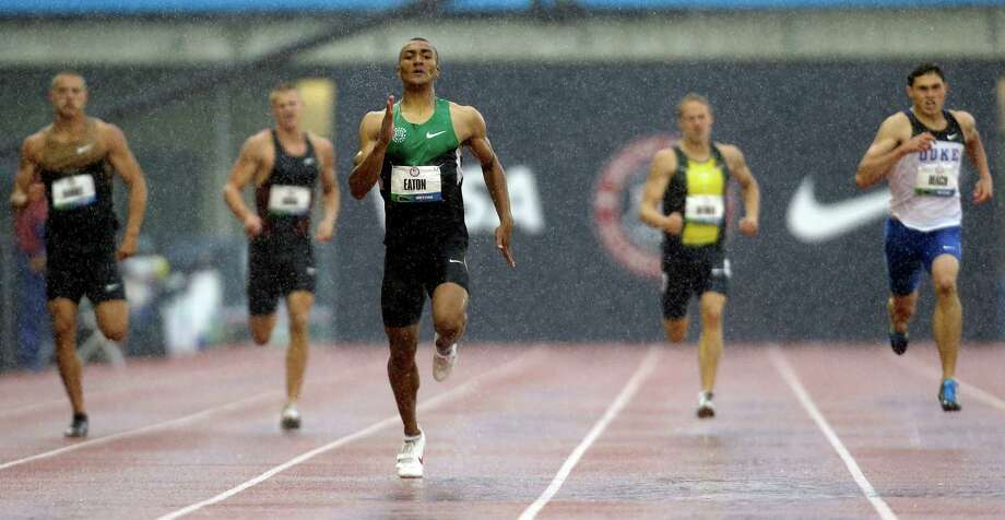 Ashton Eaton leads the 400m in a driving rain during the decathlon competition at the U.S. Olympic Track and Field Trials Friday, June 22, 2012, in Eugene, Ore. Photo: Eric Gay, Associated Press / AP