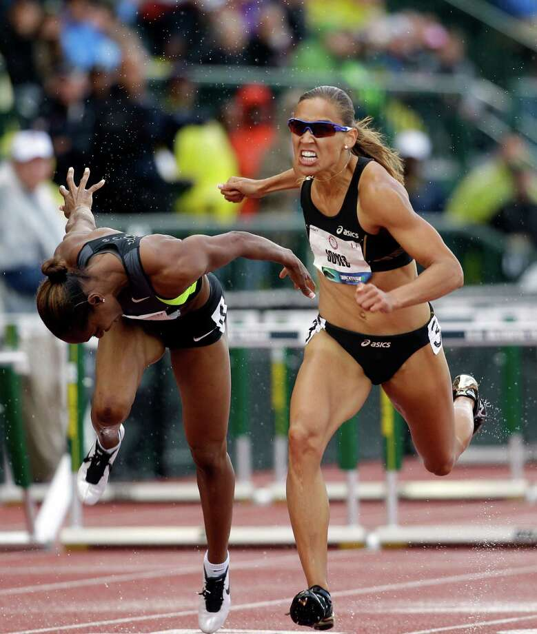 Lolo Jones and Michelle Perry compete in the women's 100m hurdles at the U.S. Olympic Track and Field Trials Saturday, June 23, 2012, in Eugene, Ore. Photo: Marcio Jose Sanchez, Associated Press / AP