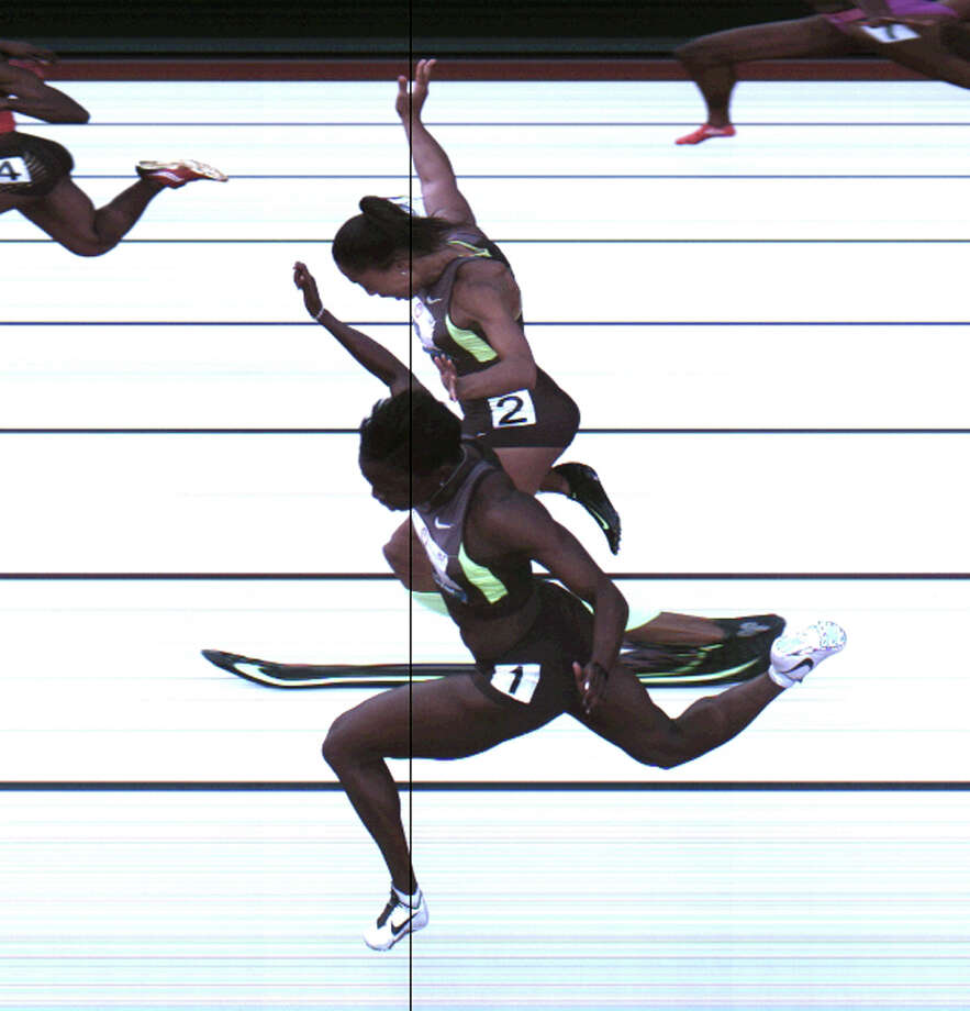 This Saturday, June 23, 2012, photo provided by USA Track & Field shows the third-place finish of the women's 100-meter final from a photo-finish camera, shot at 3,000-frames-per-second, during the U.S. Olympic Track and Field Trials in Eugene, Ore. Allyson Felix and Jeneba Tarmoh, in foreground, finished in a dead heat for the last U.S. spot in the 100 to the London Games, each leaning across the finish line in 11.068 seconds. Photo: Associated Press / USA Track & Field