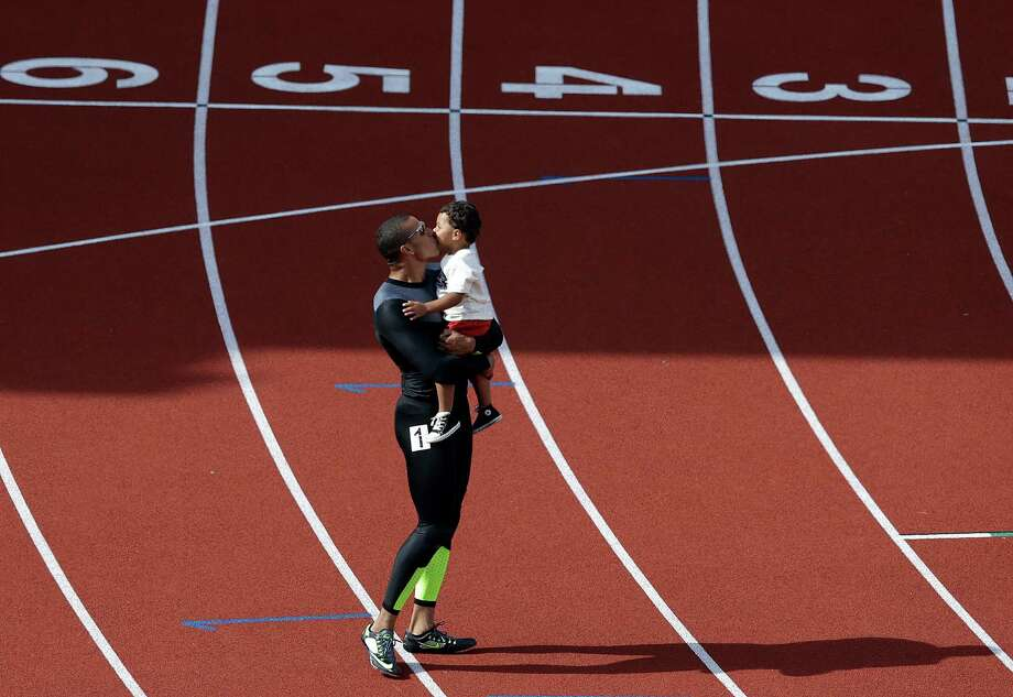 Ryan Bailey celebrates with his son Tyree after the men's 100m finals at the U.S. Olympic Track and Field Trials Sunday, June 24, 2012, in Eugene, Ore. Photo: Charlie Riedel, Associated Press / AP