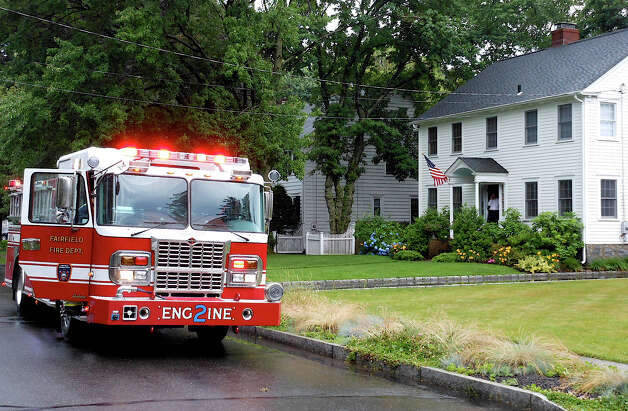 Fairfield Engine 2 in the 100 block of Lalley Boulevard, where lightning from a Monday morning storm struck a home. Photo: Mike Lauterborn / Fairfield Citizen contributed