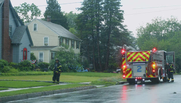 Firefighters on the scene of a Lalley Boulevard lightning strike Monday morning. The incident did not trigger a fire and no one was hurt. Photo: Mike Lauterborn / Fairfield Citizen contributed