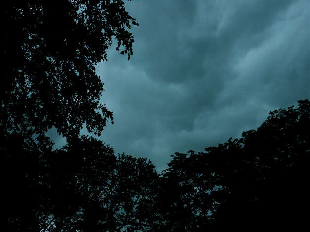 Ominous storm clouds over Fairfield as a strong thunderstorm swept through the area Monday morning. The National Weather Service issued a Severe Thunderstorm Watch for much of the day. Photo: Mike Lauterborn / Fairfield Citizen contributed