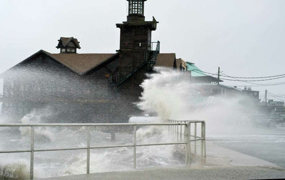 High winds, high tide strike at the main street of Cedar Key, Fla., as Tropical Storm Debby makes it's way across the Gulf of Mexico early Sunday, June 24, 2012. Parts of Florida, including the Panhandle, remain under a tropical storm warning as Debby churns off the Gulf Coast. (AP Photo/Phil Sandlin) Photo: Phil Sandlin, FRE
