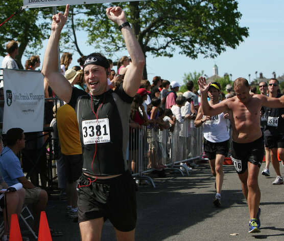 Mario Marcangei, of Greenwich, celebrates at the finish line of the annual Stratton Faxon Fairfield Half Marathon in Fairfield, Conn. on Sunday, June, 24, 2012. Photo: B.K. Angeletti / Connecticut Post