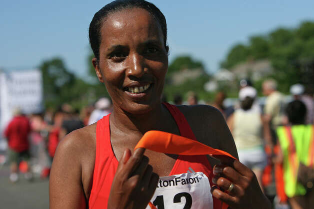 Asha Gigi, of Ethiopia,  takes third in the annual Stratton Faxon Fairfield Half Marathon in Fairfield, Conn. on Sunday, June, 24, 2012. Photo: B.K. Angeletti / Connecticut Post