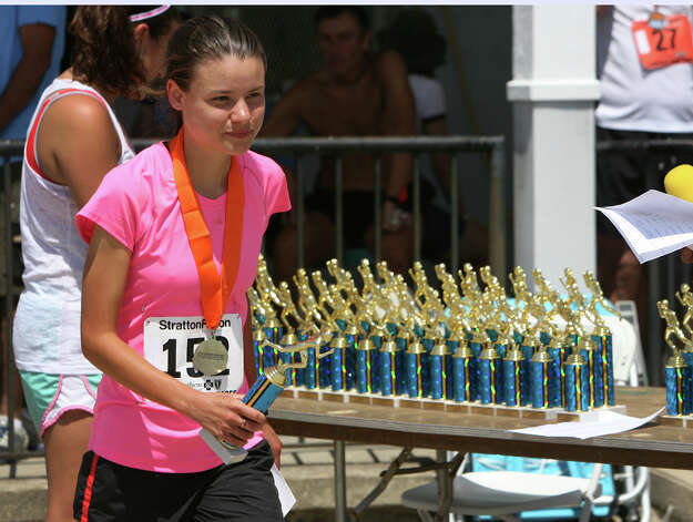 Caitlin Stote, of Stamford, of Stamford, receives a trophy at the annual Stratton Faxon Fairfield Half Marathon in Fairfield, Conn. on Sunday, June, 24, 2012. Stote took second for Conn. women and first for women 20-29 years,. Photo: B.K. Angeletti / Connecticut Post