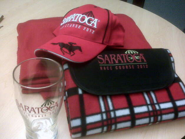 The New York Racing Association 2011 Saratoga Race Course giveaways include a picnic mat, pilsner glass, fleece blanket and baseball cap. Photo: Picasa