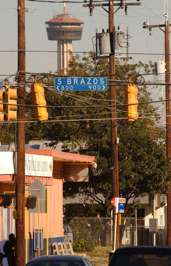 The intersection of Brazos and Guadalupe streets is one of the area's a new program could offer city employees financial assistance in purchasing their first homes. Photo: ROBERT MCLEROY, SAN ANTONIO EXPRESS-NEWS / SAN ANTONIO EXPRESS-NEWS