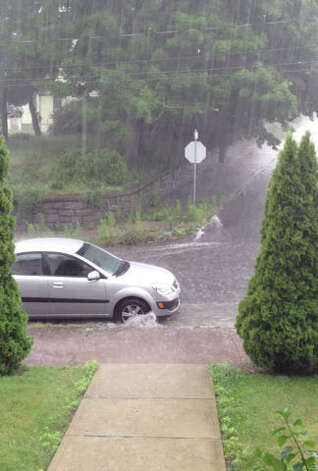Beaver Street in Ansonia was flooding out at 8 a.m.  Credit: Video still from Steven & Brittany Pirre/WTNH Report It. Photo: Contributed