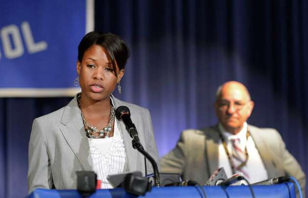 Cecily L. Wilson, an Albany High School graduate was named interim principal at her alma mater by Albany School Superintendent Raymond Colucciello, background at a press conference held at the Albany High School in Albany, N.Y. June 25, 2012.  (Skip Dickstein / Times Union) Photo: SKIP DICKSTEIN / 00018225A