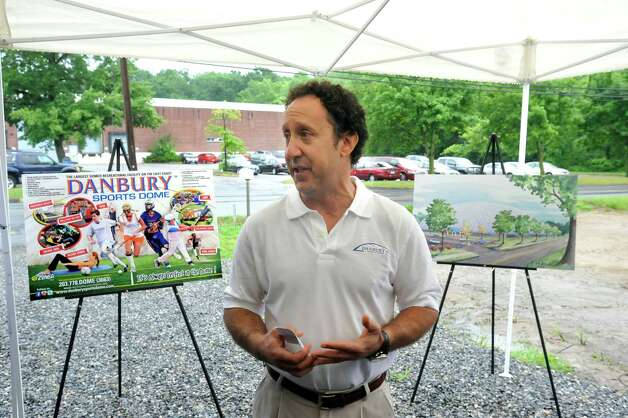 Steven Lipman, one of the directors of the Danbury Sports Dome, speaks during the ground-breaking ceremony Monday, June 25, 2012. Photo: Michael Duffy / The News-Times