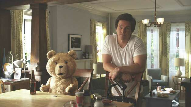 "John (Mark Wahlberg) hangs out with his best friend, the crude Ted (voiced by Seth MacFarlane), in ""Ted."" The live-action/CG-animated comedy opens Friday. Photo: Photo Credit: Universal Pictures"