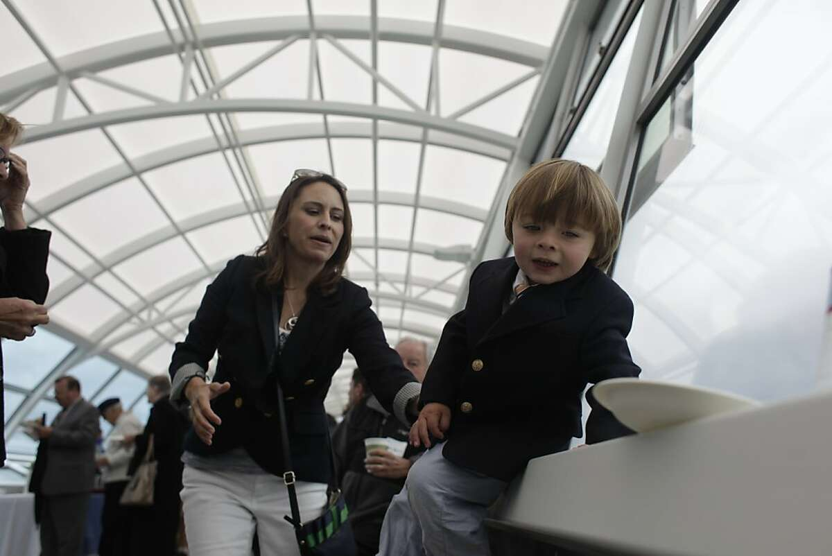 Lucca Larson (right), 3, enjoys the Oyster Point Marina Ferry Terminal with his mother Krista Martinelli (left), South San Francisco City Clerk, during the San Francisco Bay Ferry South San Francisco Inaugural Celebration.