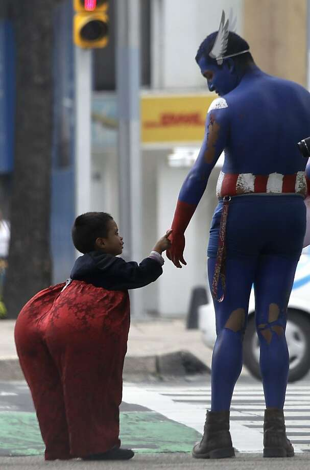 Buttinski: In Mexico City, Capt. America (a student raising money