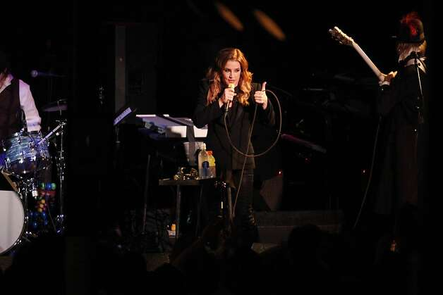 "Lisa Marie Presley gives a thumbs up to fans yelling ""I love you"" at Slim's in San Francisco Calif. on Sunday, June 24, 2012. Presley's third album 'Storm and Grace' was released May 15, approximately nine years after her first album 'To Whom It May Concern.' Photo: Alex Washburn"