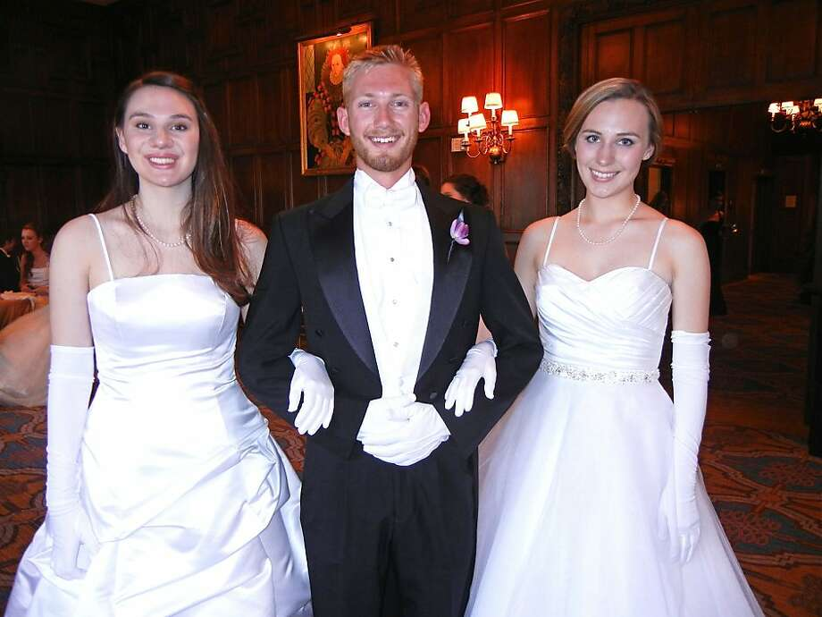 Debutante Sarah Jarman (left) with escort Tyler Browne and her twin debutante sister Charlotte Jarman. June 2012. By Catherine Bigelow. Photo: Catherine Bigelow, Special To The Chronicle
