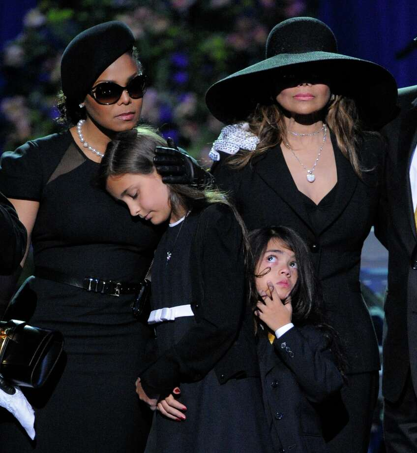 Singer Janet Jackson, left, Paris Katherine Jackson, Prince Michael Jackson II, and LaToya Jackson are seen on stage during the memorial service for Michael Jackson at the Staples Center in Los Angeles, Tuesday, July 7, 2009. (AP Photo/Mark J. Terrill, Pool) Photo: Mark J. Terrill, STF / AP Pool
