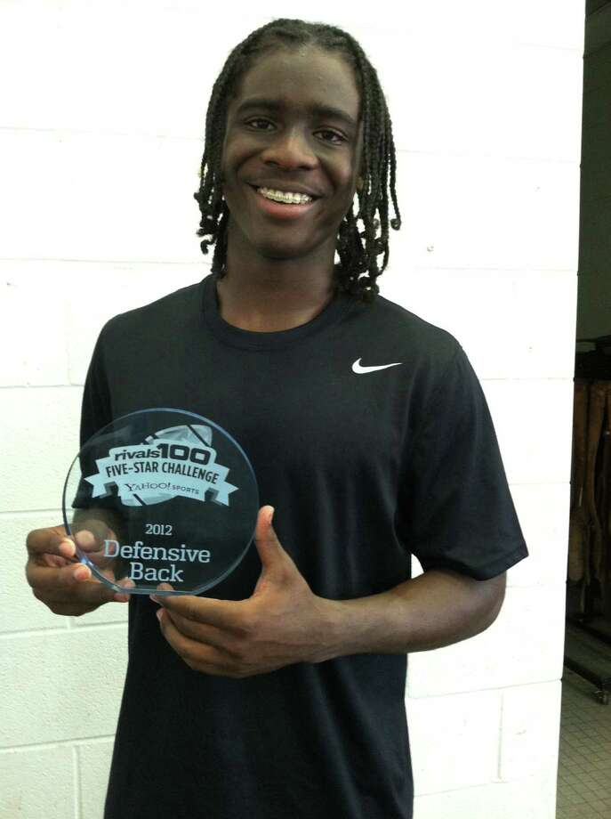 Ozen football player Tony Brown holds a trophy he won last weekend at the Rivals100 Five-Star Challenge in Atlanta. Brown, a junior, was named a top 10 defensive back at the camp. The camp was held June 22-24, 2012. Photo: Jared Ainsworth