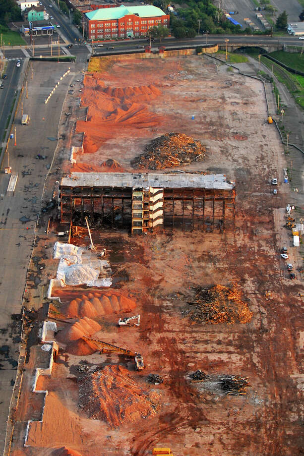 The final section of the GE property during demolition in Bridgeport, Conn. June 22nd, 2012. The huge facility was built by the Remington Arms Company between 1915 and 1916, for the production of munitions during World War I. The General Electric Company took over the property in 1920. Demolition began earlier this year.  Morgan Kaolian AEROPIX Photo: Morgan Kaolian AEROPIX / Morgan Kaolian AEROPIX