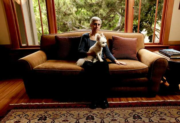 Judy Levin sits with her daughter's dog Lulu in her Oakland living room. The couch contains some dangerous chemicals. Photo: Michael Macor, The Chronicle