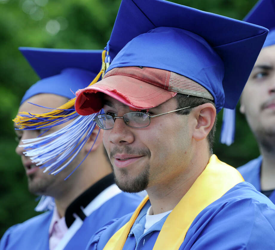 Derrick Castorina, 18, wore two hats to graduation Monday. Henry Abbott Tech held its graduation ceremony at the Ives Concert Park Monday, June 25, 2012. Photo: Carol Kaliff